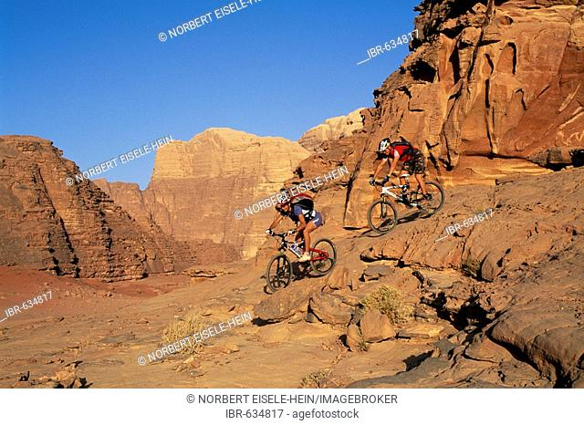 Mountain bikers, Wadi Rum, Jordan, Middle East