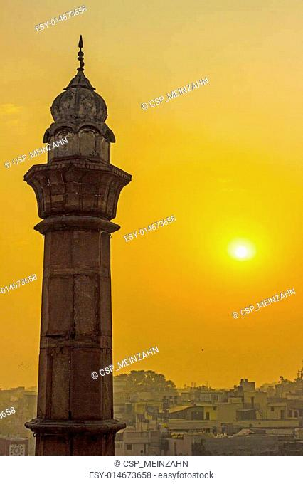minaret in Delhi in morning sun