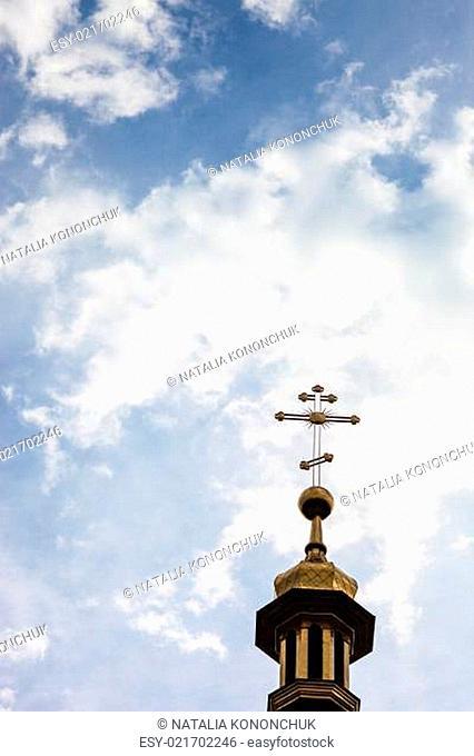 The cross of the orthodox Christian church against the cloudy sky