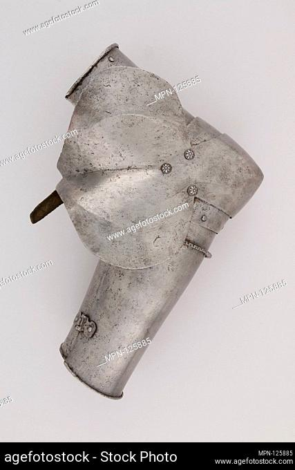Outer Plate of a Forearm Defense (Vambrace). Date: possibly ca. 1400; Culture: Italian; Medium: Steel, leather; Dimensions: H. 7 3/4 in. (19.7 cm); W