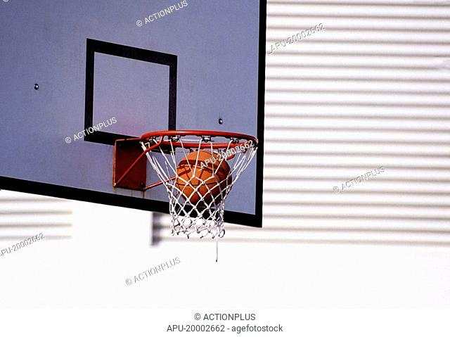 Basketball dropping into the net