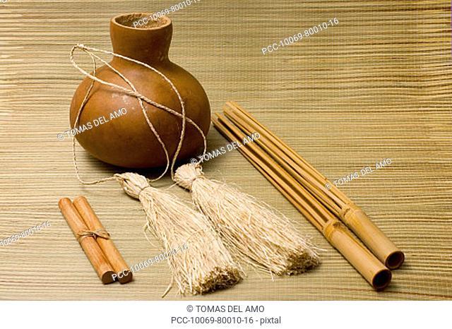 Studio shot of hula implements, ipu, pu'ili and kala'au