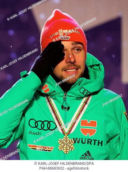 Johannes Rydzek celebrates the victory during the Medal Ceremony after the team sprint of the combination large hill/2 x 7