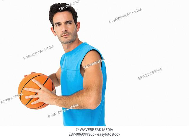 Serious basketball player with ball