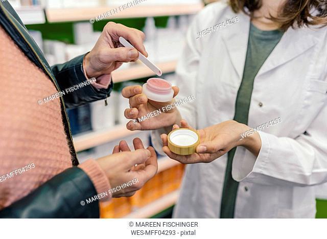 Customer testing cosmetics in pharmacy