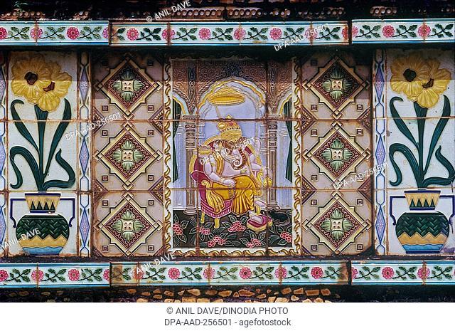 Ganpati painting on tulsi vrindavan ceramic tiles, mangeshi temple, Goa, india, asia