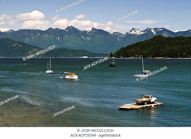 The view of BC's Coast mountains from Gibson's Landing BC on the Sunshine Coast, Home of the 'Beachcombers' TV show