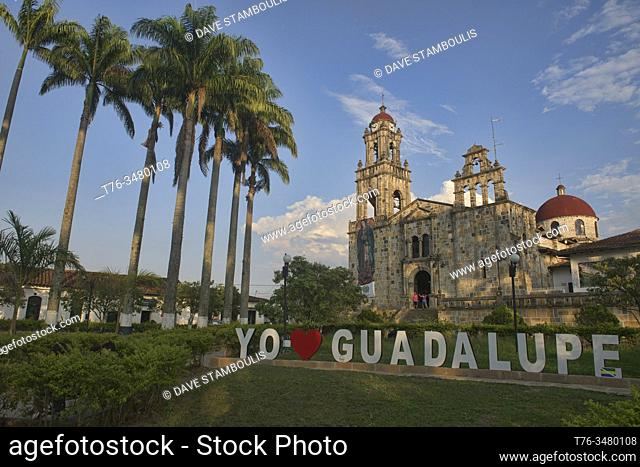 The Parroquia Santuario Nuestra Señora de Guadalupe church and palm tree plaza of Guadalupe, Santander, Colombia