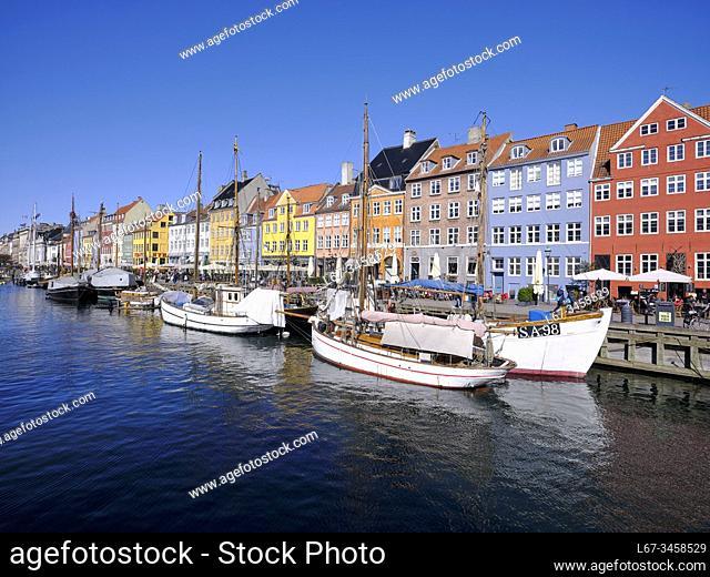 Working boats at dock during summer in Nyhavn, Copenhagen