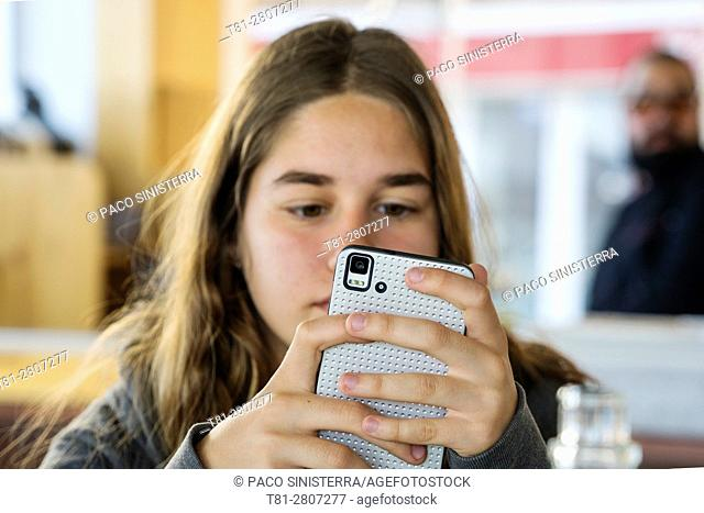 girl looking at mobile phone, Castellon