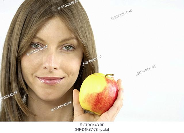 Mid adult woman holding an apple