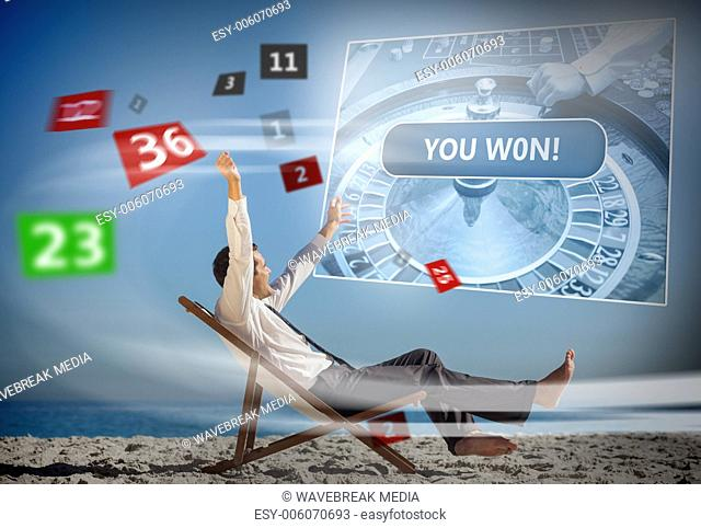 Businessman sitting on deck chair looking at holographic screen and numbers