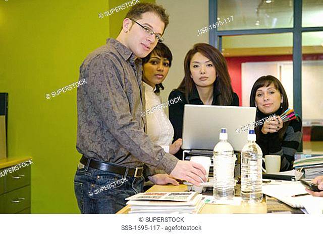 Businessman with three businesswomen in an office