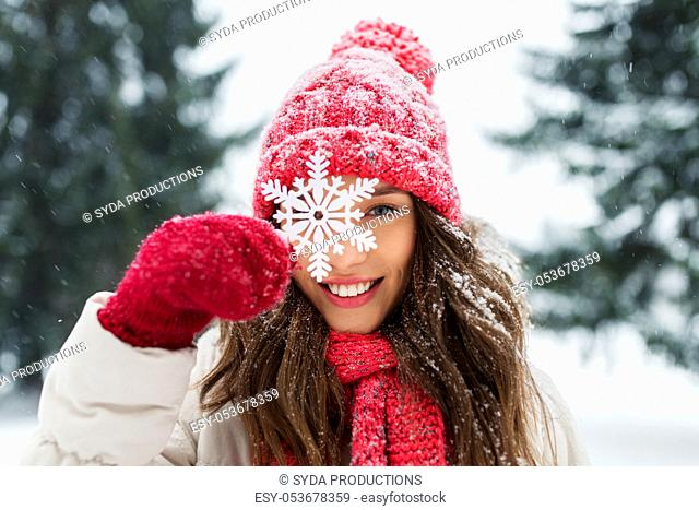 portrait of teenage girl with snowflake in winter