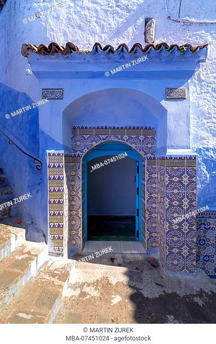 Entrance door in a blue alley in Chefchaouen, Morocco, North Africa, Africa