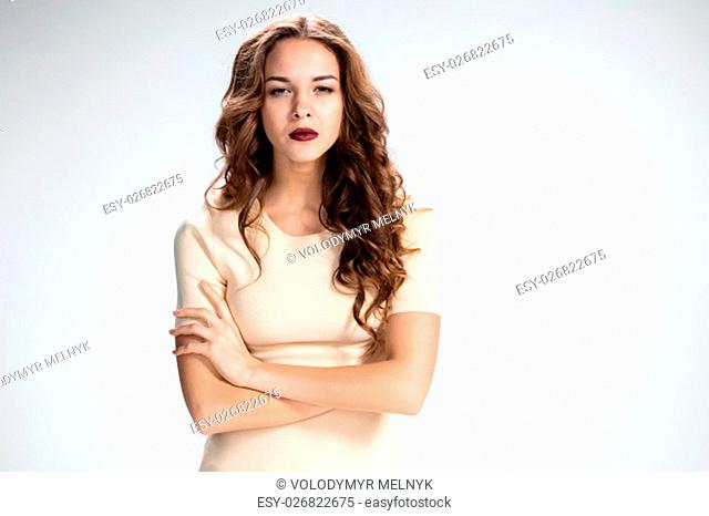 The young strong girl on gray background