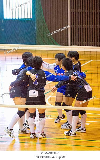 High School Girls Playing Volley Ball