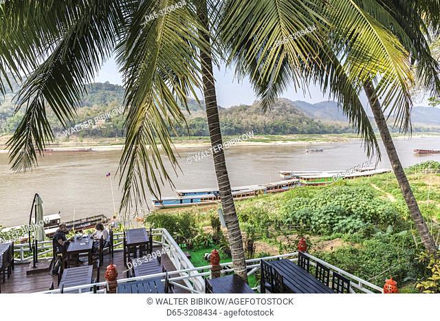 Laos, Luang Prabang, people at Mekong Riverfront cafe, NR