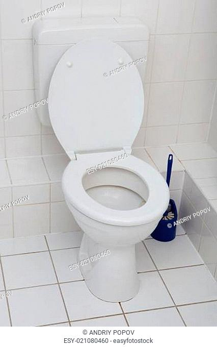 White Toilet Bowl In A Clean Bathroom