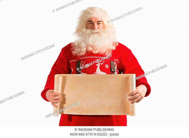 Santa Claus holding vintage paper blank sign isolated on white background