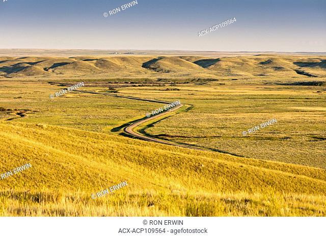 Road winding through Grasslands National Park in Saskatchewan, Canada