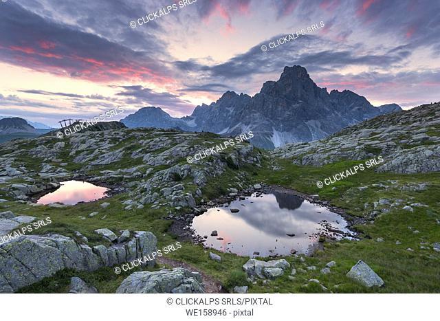Cavallazza Lakes at sunrise towards Pale di San Martino