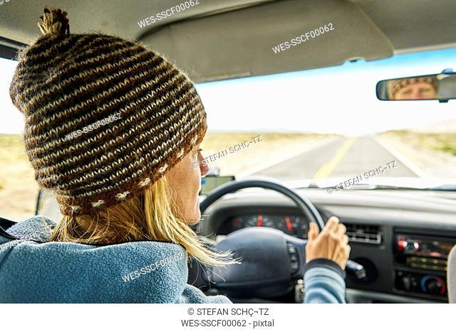 Peru, Arequipa, woman driving car on Panamericana