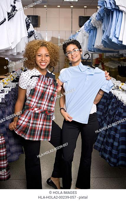 Young women in uniform shop