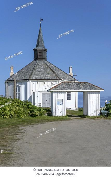 portal and octagonal historical church at Artic village, shot under bright summer light near Dverberg, Andoya, Vesteralen, Norway