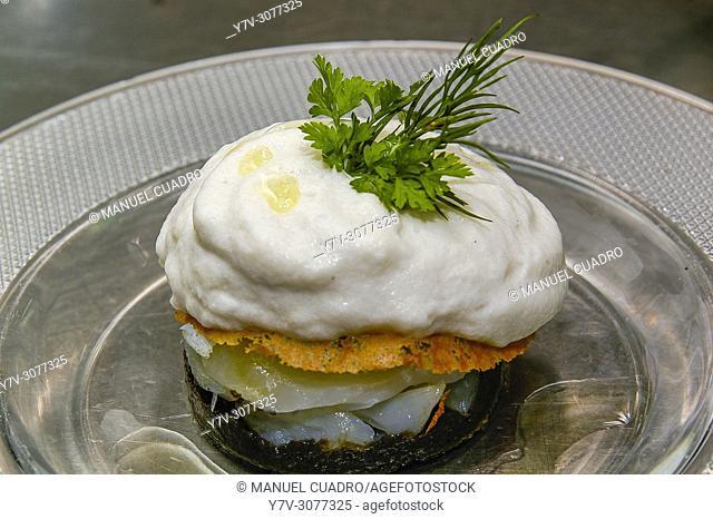 Pintxo de Láminas de bacalao, pasta de olivas negras, anchoas ahumadas y jugo de tomate. Restaurante Yandiola. Basque Country, Spain