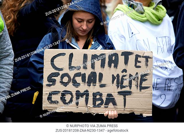 December 8, 2018 - Toulouse, France - A young woman holds a placard reading Climate and Socila, same fight'. A March for the Climate took place in Toulouse with...