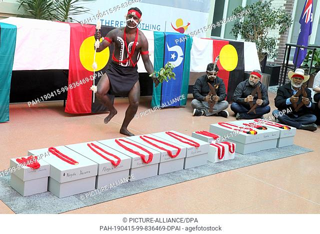15 April 2019, Berlin: Native Australians, Aborigines, participate in the return of the remains of indigenous Australians from the State Ethnographic...