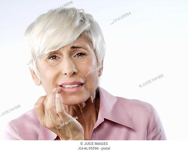 Senior woman with toothache