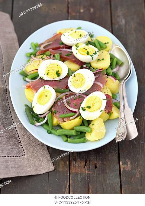 Salad Nicoise with green beans, potatoes, smoked tuna and boiled eggs
