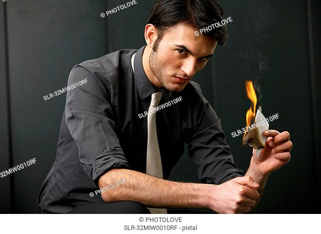 Businessman burning paper