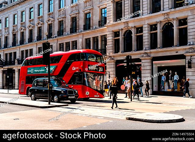 London, UK - May 15, 2019: Busy street scene with unidentified people and red bus at Regent Street. It is one of the major shopping destinations in London with...