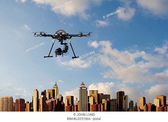 Surveillance drone hovering over city skyline