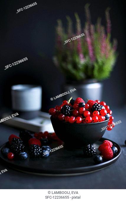 Summer berries in dark bowl