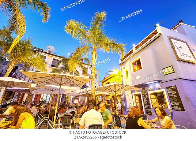 Restaurant terraces at the Port district by night. Denia. Alicante. Valencia Community. Spain