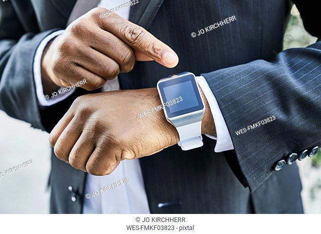 Mature businessman wearing smartwatch