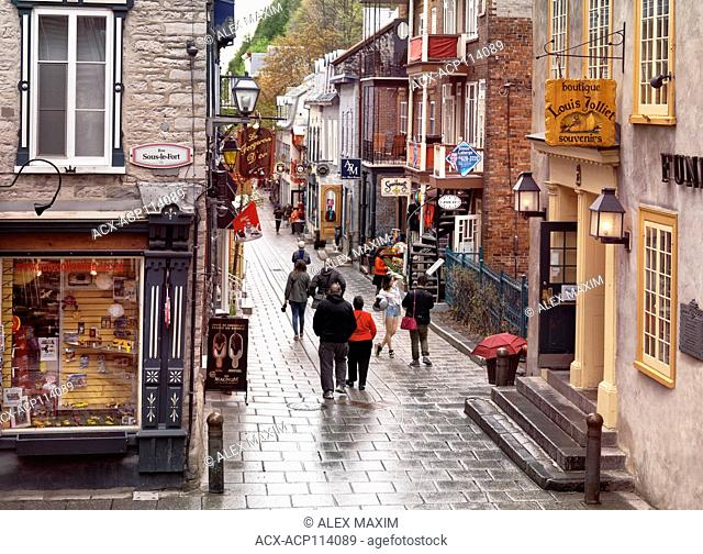Petit Champlain historic street in old Quebec City with its colorful shop windows and restaurants. Boutique Louis Jolliet, Le Forgeron d'Or
