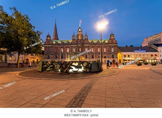 Illuminated town hall against blue sky at night in Malmo, Sweden
