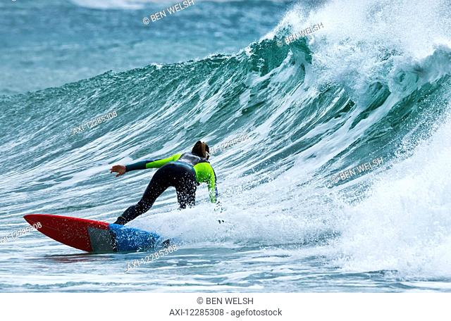 Surfer catching a wave; Tarifa, Cadiz, Andalusia, Spain