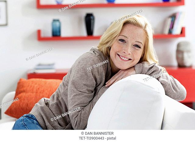 Portrait of young woman relaxing at home