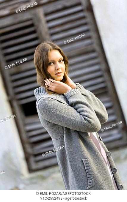 Teenager girl outdoors dressed in coat and pants