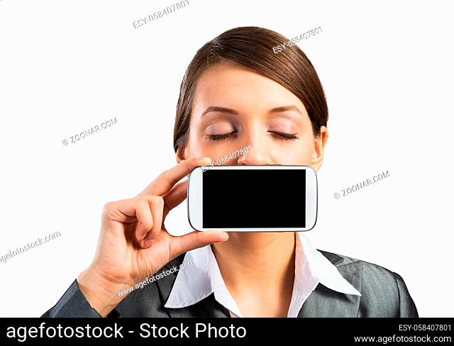 Pretty woman with closed eyes showing mobile phone near her face. Businesswoman holding smartphone with blank screen. Corporate businessperson isolated on white...