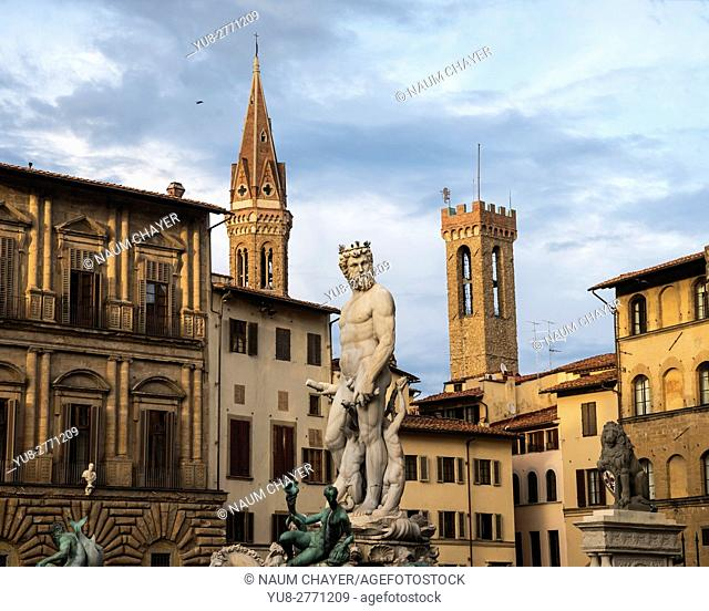 Golden rays of the setting sun painted Fountain of Neptune on the Piazza della Signoria, Florence, , Tuscany, Italy