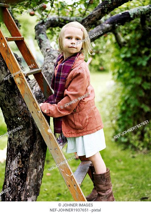 Girl in orchard, Varmdo, Uppland, Sweden