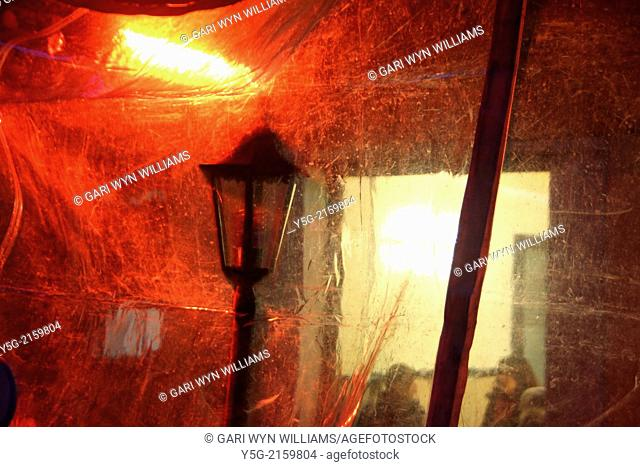 plastic covering with red light at an outsite sitting area of a bar in rome italy