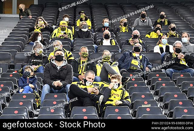 24 October 2020, Dortmund: Football, Bundesliga, Borussia Dortmund - Schalke 04, 5th matchday, Signal Iduna Park: Spectators sitting in the stands